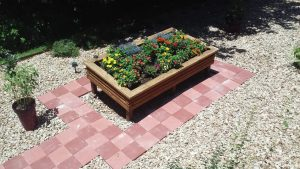 paver walkway around raised flowerbed