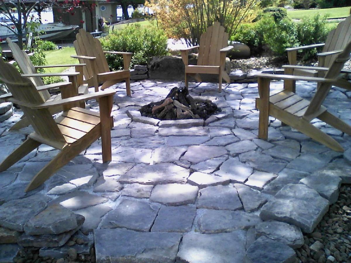 native stone patio and firepit fueled by propane
